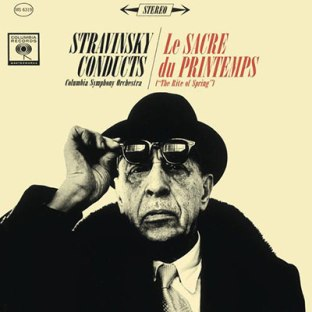 Igor Stravinsky in a giant coat, a hat, and sunglasses